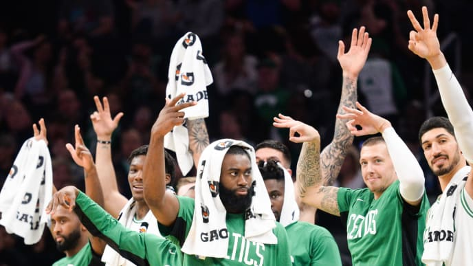 BOSTON, MA - OCTOBER 13: Jaylen Brown #7, Daniel Theis #27, and Enes Kanter #11 of the Boston Celtics react on the bench after a teammate makes a three pointer in the fourth quarter against the Cleveland Cavaliers at TD Garden on October 13, 2019 in Boston, Massachusetts. NOTE TO USER: User expressly acknowledges and agrees that, by downloading and or using this photograph, User is consenting to the terms and conditions of the Getty Images License Agreement. (Photo by Kathryn Riley/Getty Images)