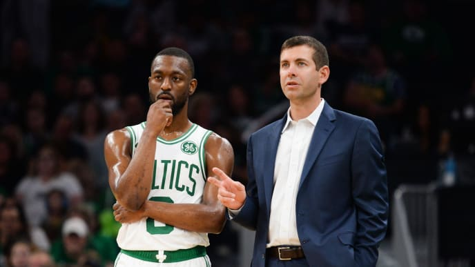 BOSTON, MA - OCTOBER 13: Kemba Walker #8 of the Boston Celtics talks with head coach Brad Stevens during the second quarter against the Cleveland Cavaliers at TD Garden on October 13, 2019 in Boston, Massachusetts. NOTE TO USER: User expressly acknowledges and agrees that, by downloading and or using this photograph, User is consenting to the terms and conditions of the Getty Images License Agreement. (Photo by Kathryn Riley/Getty Images)