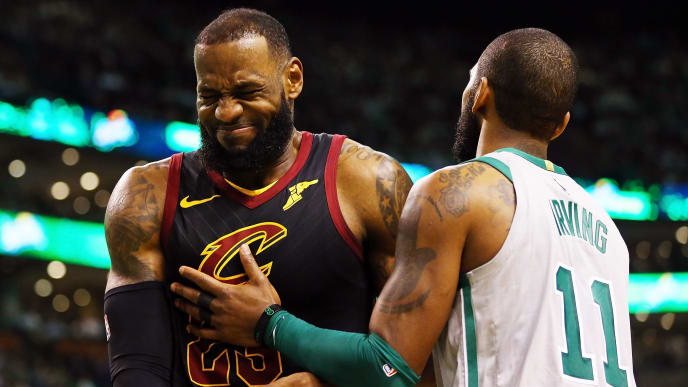 BOSTON, MA - FEBRUARY 11:  Lebron James #23 of the Cleveland Cavaliers reacts with Kyrie Irving #11 of the Boston Celtics during the first quarter of a game at TD Garden on February 11, 2018 in Boston, Massachusetts. NOTE TO USER: User expressly acknowledges and agrees that, by downloading and or using this photograph, User is consenting to the terms and conditions of the Getty Images License Agreement.  (Photo by Adam Glanzman/Getty Images)