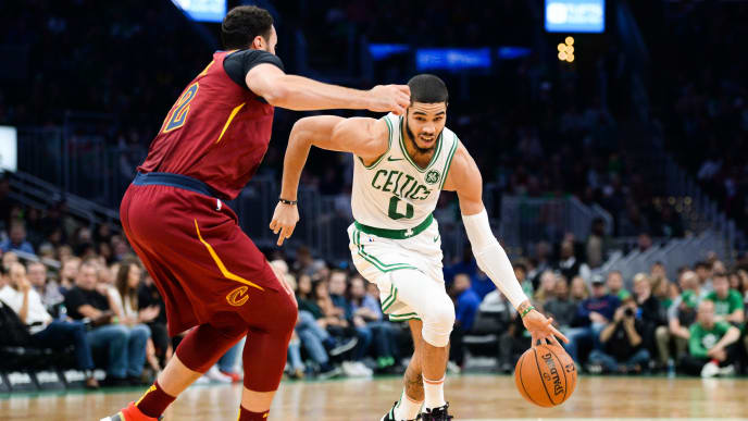 BOSTON, MA - OCTOBER 13: Jayson Tatum #0 of the Boston Celtics drives past Larry Nance Jr. #22 of the Cleveland Cavaliers in the first quarter at TD Garden on October 13, 2019 in Boston, Massachusetts. NOTE TO USER: User expressly acknowledges and agrees that, by downloading and or using this photograph, User is consenting to the terms and conditions of the Getty Images License Agreement. (Photo by Kathryn Riley/Getty Images)