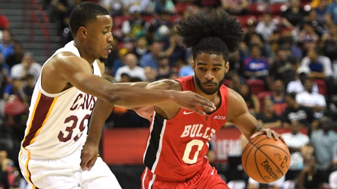LAS VEGAS, NEVADA - JULY 07:  Coby White #0 of the Chicago Bulls brings the ball up the court against Muhammad-Ali Abdur-Rahkman #39 of the Cleveland Cavaliers during the 2019 NBA Summer League at the Thomas & Mack Center on July 7, 2019 in Las Vegas, Nevada. NOTE TO USER: User expressly acknowledges and agrees that, by downloading and or using this photograph, User is consenting to the terms and conditions of the Getty Images License Agreement.  (Photo by Ethan Miller/Getty Images)