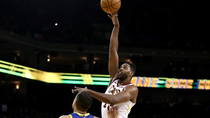 OAKLAND, CALIFORNIA - APRIL 05:  Tristan Thompson #13 of the Cleveland Cavaliers shoots over Andrew Bogut #12 of the Golden State Warriors at ORACLE Arena on April 05, 2019 in Oakland, California.  NOTE TO USER: User expressly acknowledges and agrees that, by downloading and or using this photograph, User is consenting to the terms and conditions of the Getty Images License Agreement. (Photo by Ezra Shaw/Getty Images)