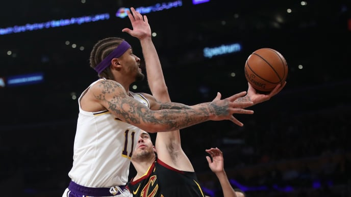 LOS ANGELES, CA - JANUARY 13:  Michael Beasley #11 of the Los Angeles Lakers lays up a shot past the defense of Ante Zizic #41 of the Cleveland Cavaliers during the first half of a game at Staples Center on January 13, 2019 in Los Angeles, California.  NOTE TO USER: User expressly acknowledges and agrees that, by downloading and or using this photograph, User is consenting to the terms and conditions of the Getty Images License Agreement.  (Photo by Sean M. Haffey/Getty Images)