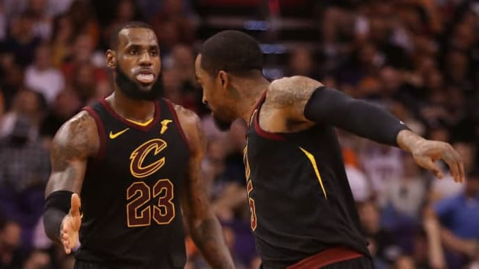 PHOENIX, AZ - MARCH 13:  LeBron James #23 of the Cleveland Cavaliers high fives JR Smith #5 after scoring against the Phoenix Suns during the second half of the NBA game at Talking Stick Resort Arena on March 13, 2018 in Phoenix, Arizona. The Cavaliers defeated the Suns 129-107. NOTE TO USER: User expressly acknowledges and agrees that, by downloading and or using this photograph, User is consenting to the terms and conditions of the Getty Images License Agreement.  (Photo by Christian Petersen/Getty Images)