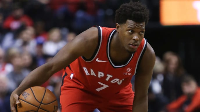 TORONTO, ON - OCTOBER 17:  Kyle Lowry #7 of the Toronto Raptors dribbles the ball during the second half of the NBA season opener against the Cleveland Cavaliers at Scotiabank Arena on October 17, 2018 in Toronto, Canada.  NOTE TO USER: User expressly acknowledges and agrees that, by downloading and or using this photograph, User is consenting to the terms and conditions of the Getty Images License Agreement.  (Photo by Vaughn Ridley/Getty Images)