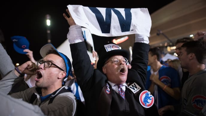 CLEVELAND, OH - NOVEMBER 03: Joe Wiegand of Colorado Springs, Colo., a Theodore Roosevelt impersonator and self-proclaimed Cubs fan, celebrates after the Chicago Cubs defeated the Cleveland Indians in game 7 of the World Series in the early morning hours on November 3, 2016 in Cleveland, Ohio. The Cubs defeated the Indians 8-7 in 10 innings for their first World Series championship in 108 years. (Photo by Justin Merriman/Getty Images)