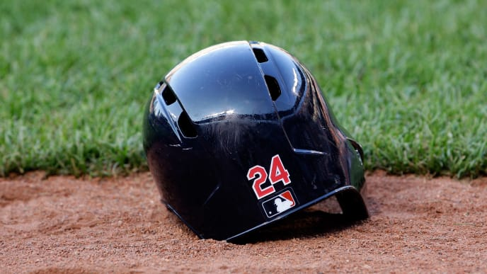 BALTIMORE, MD - JUNE 25: The batting helmet of Michael Bourn #24 of the Cleveland Indians sits on the ground before the start of the Indians and Baltimore Orioles game at Oriole Park at Camden Yards on June 25, 2013 in Baltimore, Maryland.  (Photo by Rob Carr/Getty Images)