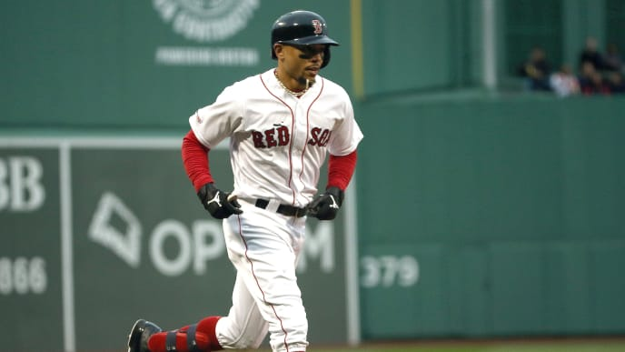 BOSTON, MA - MAY 29: Mookie Betts #50 of the Boston Red Sox rounds the bases after hitting a home run against the Cleveland Indians in the first inning at Fenway Park on May 29, 2019 in Boston, Massachusetts. (Photo by Jim Rogash/Getty Images)