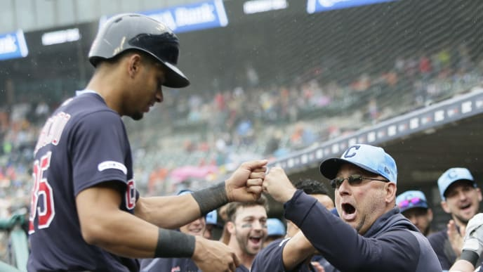 DETROIT, MI - JUNE 16:  Oscar Mercado #35 of the Cleveland Indians receives a fist bump from manager Terry Francona #77 of the Cleveland Indians after scoring on a home run hit against the Detroit Tigers by Jason Kipnis during the third inning at Comerica Park on June 16, 2019 in Detroit, Michigan. (Photo by Duane Burleson/Getty Images)