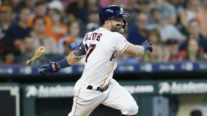 HOUSTON, TEXAS - APRIL 27: Jose Altuve #27 of the Houston Astros singles in the eighth inning against the Cleveland Indians at Minute Maid Park on April 27, 2019 in Houston, Texas. (Photo by Bob Levey/Getty Images)