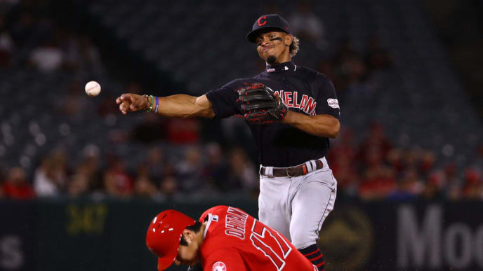 ANAHEIM, CALIFORNIA - SEPTEMBER 10: Francisco Lindor #12 of the Cleveland Indians throws to first base to turn the double play as Shohei Ohtani #17 of the Los Angeles Angels slides into second base during the fourth inning of the MLB game at Angel Stadium of Anaheim on September 10, 2019 in Anaheim, California. (Photo by Victor Decolongon/Getty Images)