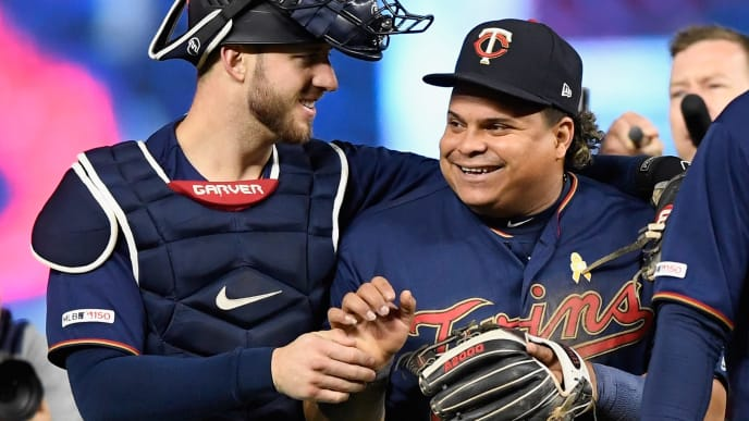 MINNEAPOLIS, MINNESOTA - SEPTEMBER 07: Mitch Garver #18 and Willians Astudillo #64 of the Minnesota Twins celebrate defeating the Cleveland Indians after the game at Target Field on September 7, 2019 in Minneapolis, Minnesota. The Twins defeated the Indians 5-3. (Photo by Hannah Foslien/Getty Images)