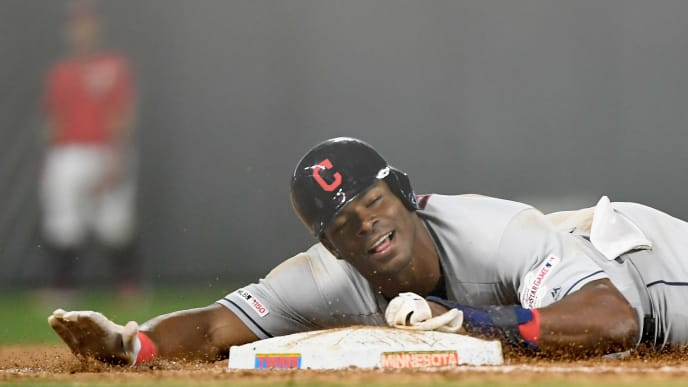 MINNEAPOLIS, MN - AUGUST 09: Yasiel Puig #66 of the Cleveland Indians slides safely into third base against the Minnesota Twins during the ninth inning of the game on August 9, 2019 at Target Field in Minneapolis, Minnesota. The Indians defeated the Twins 6-2. (Photo by Hannah Foslien/Getty Images)