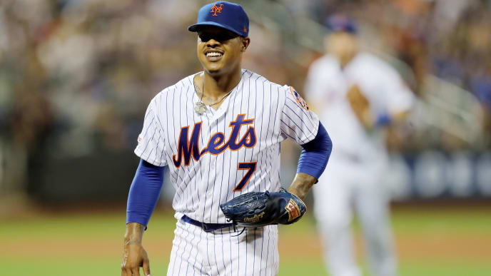 NEW YORK, NEW YORK - AUGUST 21:  Marcus Stroman #7 of the New York Mets smiles after he got the force out at first to end the fourth inning at Citi Field on August 21, 2019 in the Flushing neighborhood of the Queens borough of New York City. (Photo by Elsa/Getty Images)