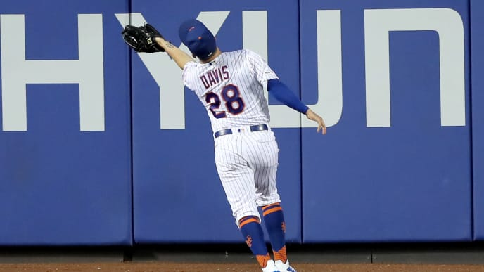 NEW YORK, NEW YORK - AUGUST 22:  J.D. Davis #28 of the New York Mets catches a hit by Greg Allen #1 of the Cleveland Indians for the out tin the fourth inning at Citi Field on August 22, 2019 in the Flushing neighborhood of the Queens borough of New York City. (Photo by Elsa/Getty Images)