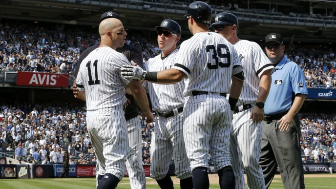 NEW YORK, NEW YORK - AUGUST 17:   Brett Gardner #11 of the New York Yankees is restrained by teammates as he argues with the umpires after his sixth inning ejection against the Cleveland Indians at Yankee Stadium on August 17, 2019 in New York City. (Photo by Jim McIsaac/Getty Images)