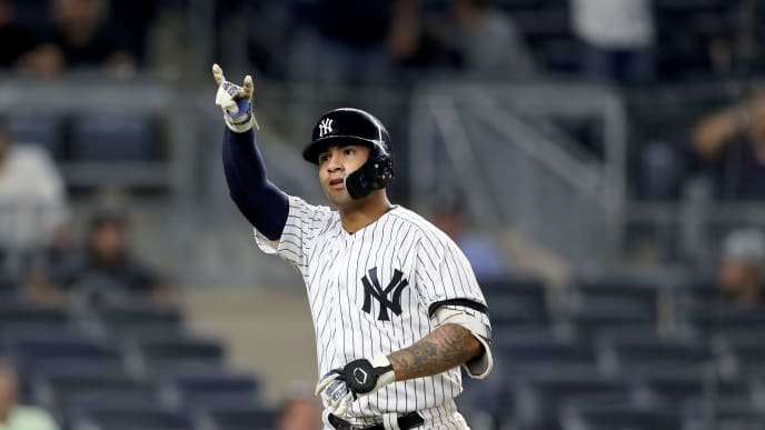 NEW YORK, NEW YORK - AUGUST 15:  Gleyber Torres #25 of the New York Yankees celebrates his solo home run in the eighth inning against the Cleveland Indians at Yankee Stadium on August 15, 2019 in the Bronx borough of New York City. (Photo by Elsa/Getty Images)