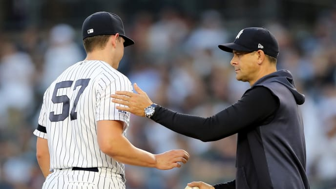 NEW YORK, NEW YORK - AUGUST 15:  Chad Green #57 of the New York Yankees is pulled from the game by manager Aaron Boone #17 of the New York Yankees in the first inning against the Cleveland Indians at Yankee Stadium on August 15, 2019 in the Bronx borough of New York City. (Photo by Elsa/Getty Images)