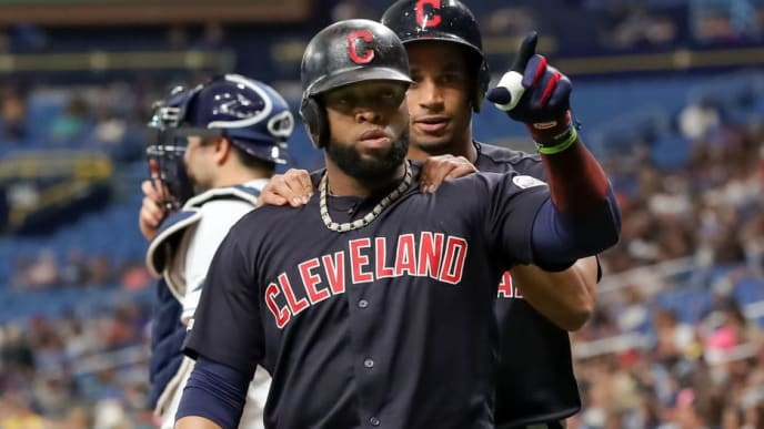 ST. PETERSBURG, FL - AUGUST 31: Carlos Santana #41 of the Cleveland Indians (C) is congratulated by Oscar Mercado #35 behind Travis d'Arnaud #37 of the Tampa Bay Rays after his home run in the first inning of a baseball game at Tropicana Field on August 31, 2019 in St. Petersburg, Florida. (Photo by Mike Carlson/Getty Images)