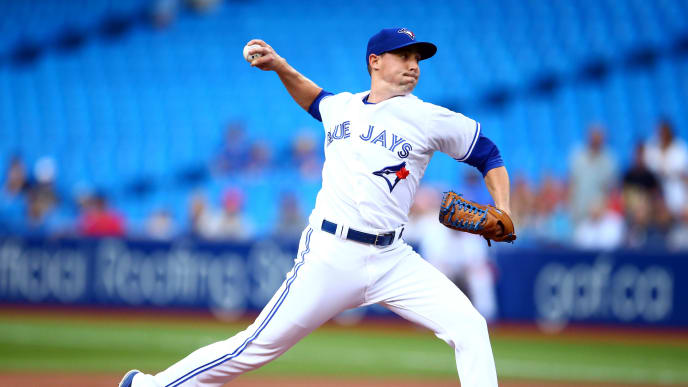 TORONTO, ON - JULY 23:  Aaron Sanchez #41 of the Toronto Blue Jays delivers a pitch in the first inning during a MLB game against the Cleveland Indians at Rogers Centre on July 23, 2019 in Toronto, Canada.  (Photo by Vaughn Ridley/Getty Images)