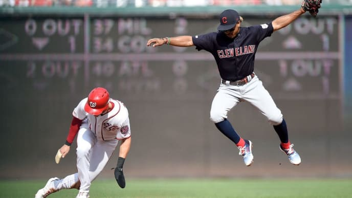 WASHINGTON, DC - SEPTEMBER 29:  Trea Turner #7 of the Washington Nationals steals second base in the first inning on a high throw to Francisco Lindor #12 of the Cleveland Indians at Nationals Park on September 29, 2019 in Washington, DC.  (Photo by Greg Fiume/Getty Images)