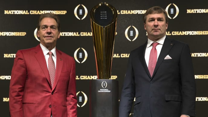 ATLANTA, GA - JANUARY 07:  University of Alabama head coach Nick Saban (left) and University of Georgia head coach Kirby Smart stand with the College Football Playoff National Championship trophy after a Coaches Press Conference on January 7, 2018 in Atlanta, Georgia.  (Photo by Mike Zarrilli/Getty Images)