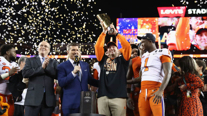 SANTA CLARA, CA - JANUARY 07:  Head coach Dabo Swinney of the Clemson Tigers celebrates his teams 44-16 win over the Alabama Crimson Tide with the trophy in the CFP National Championship presented by AT&T at Levi's Stadium on January 7, 2019 in Santa Clara, California.  (Photo by Ezra Shaw/Getty Images)