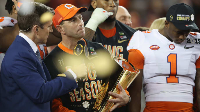SANTA CLARA, CA - JANUARY 07:  Head coach Dabo Swinney of the Clemson Tigers celebrates his teams 44-16 win over the Alabama Crimson Tide with the trophy in the CFP National Championship presented by AT&T at Levi's Stadium on January 7, 2019 in Santa Clara, California.  (Photo by Sean M. Haffey/Getty Images)