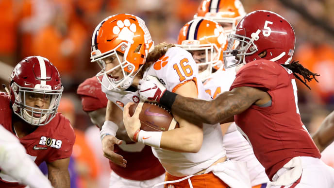 SANTA CLARA, CA - JANUARY 07:  Trevor Lawrence #16 of the Clemson Tigers carries the ball against Shyheim Carter #5 of the Alabama Crimson Tide during the fourth quarter in the CFP National Championship presented by AT&T at Levi's Stadium on January 7, 2019 in Santa Clara, California.  (Photo by Christian Petersen/Getty Images)
