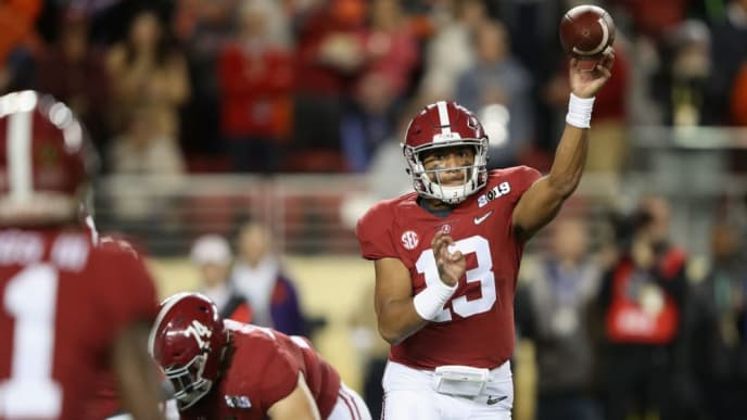 SANTA CLARA, CA - JANUARY 07:  Tua Tagovailoa #13 of the Alabama Crimson Tide looks to pass against the Clemson Tigers in the CFP National Championship presented by AT&T at Levi's Stadium on January 7, 2019 in Santa Clara, California.  (Photo by Sean M. Haffey/Getty Images)