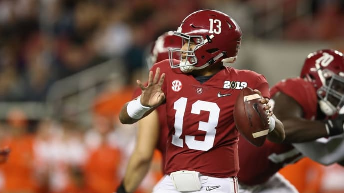 SANTA CLARA, CA - JANUARY 07:  Tua Tagovailoa #13 of the Alabama Crimson Tide looks to pass against the Clemson Tigers in the CFP National Championship presented by AT&T at Levi's Stadium on January 7, 2019 in Santa Clara, California.  (Photo by Ezra Shaw/Getty Images)
