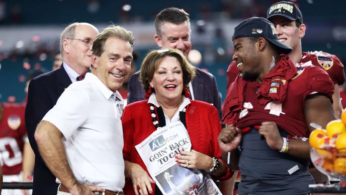 MIAMI, FL - DECEMBER 29: Head coach Nick Saban of the Alabama Crimson Tide celebrates with his wife after the win over the Oklahoma Sooners during the College Football Playoff Semifinal at the Capital One Orange Bowl at Hard Rock Stadium on December 29, 2018 in Miami, Florida.  (Photo by Jamie Squire/Getty Images)