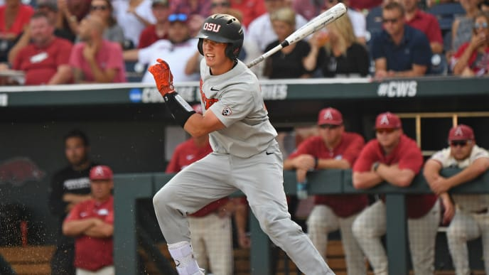Omaha, NE - JUNE 28:  Catcher Adley Rutschman #35 of the Oregon State Beavers singes in a run in the first inning against the Arkansas Razorbacks during game three of the College World Series Championship Series on June 28, 2018 at TD Ameritrade Park in Omaha, Nebraska.  (Photo by Peter Aiken/Getty Images)