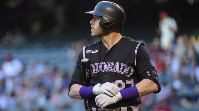 PHOENIX, ARIZONA - JUNE 18: Trevor Story #27 of the Colorado Rockies reacts while at bat in the first inning of a MLB game against the Arizona Diamondbacks at Chase Field on June 18, 2019 in Phoenix, Arizona. (Photo by Jennifer Stewart/Getty Images)