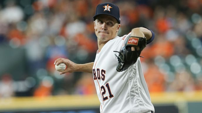 HOUSTON, TEXAS - AUGUST 06: Zack Greinke #21 of the Houston Astros pitches in the first inning against the Colorado Rockies at Minute Maid Park on August 06, 2019 in Houston, Texas. Greinke is starting his first game with the Astros since being traded by the Arizona Diamondbacks.  (Photo by Bob Levey/Getty Images)