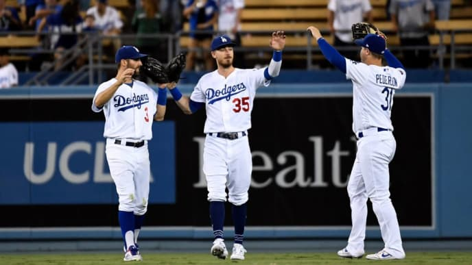 LOS ANGELES, CA - SEPTEMBER 04: Cody Bellinger #35, Joc Pederson #31and Chris Taylor #3 of the Los Angeles Dodgers celebrate after defeating the Colorado Rockies, 7-3, at Dodger Stadium on September 4, 2019 in Los Angeles, California. (Photo by Kevork Djansezian/Getty Images)