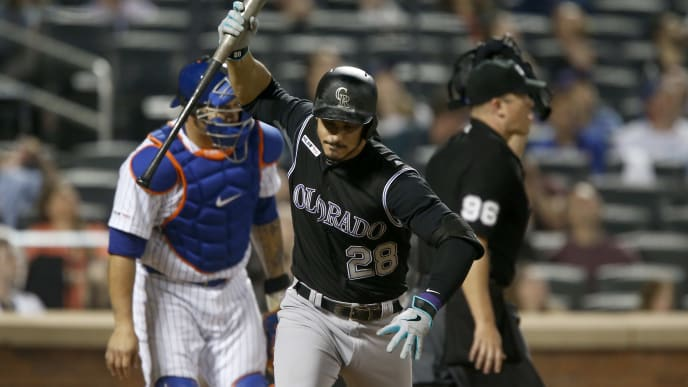 NEW YORK, NEW YORK - JUNE 07:   Nolan Arenado #28 of the Colorado Rockies slams his bat after popping out in the sixth inning against the New York Mets at Citi Field on June 07, 2019 in New York City. (Photo by Jim McIsaac/Getty Images)