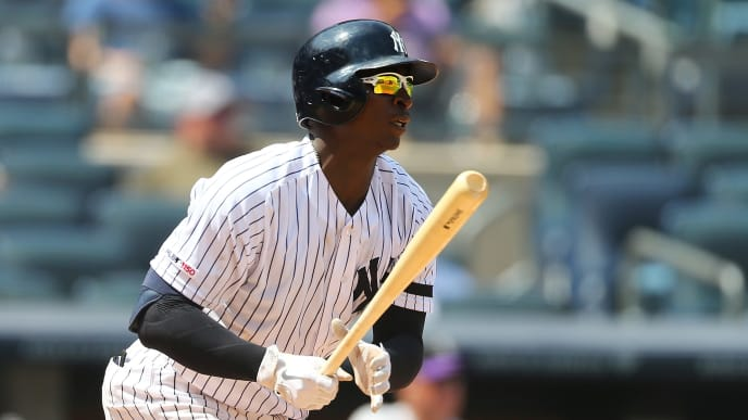 NEW YORK, NEW YORK - JULY 20:  Didi Gregorius #18 of the New York Yankees hits a RBI infield single in the fourth inning against the Colorado Rockies at Yankee Stadium on July 20, 2019 in New York City. (Photo by Mike Stobe/Getty Images)