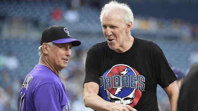 SAN DIEGO, CA - AUGUST 8: Former NBA player Bill Walton player talks with Bud Black #10 of the Colorado Rockies before a baseball game against the San Diego Padres at Petco Park August 8, 2019 in San Diego, California.  (Photo by Denis Poroy/Getty Images)