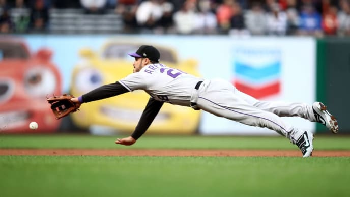 SAN FRANCISCO, CALIFORNIA - JUNE 24:   Nolan Arenado #28 of the Colorado Rockies can not field a ground ball hit by Alex Dickerson #8 of the San Francisco Giants in the first inning at Oracle Park on June 24, 2019 in San Francisco, California. (Photo by Ezra Shaw/Getty Images)