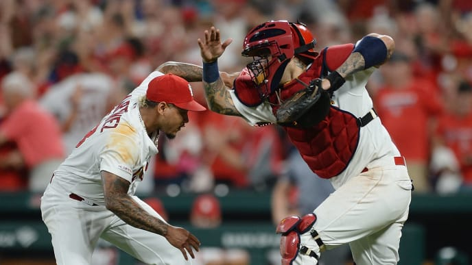 ST. LOUIS, MO - AUGUST 22: Closing pitcher Carlos Martinez #18 and Yadier Molina #4, both of the St. Louis Cardinals celebrate after defeating the Colorado Rockies 6-5 at Busch Stadium on August 22, 2019 in St. Louis, Missouri. (Photo by Michael B. Thomas/Getty Images)