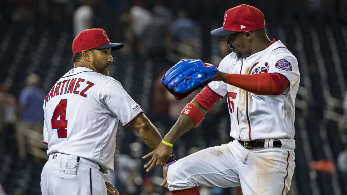 WASHINGTON, DC - JULY 24: Manager Dave Martinez #4 of the Washington Nationals celebrates with Victor Robles #16 after game two of a doubleheader against the Colorado Rockies at Nationals Park on June 24, 2019 in Washington, DC. (Photo by Scott Taetsch/Getty Images)
