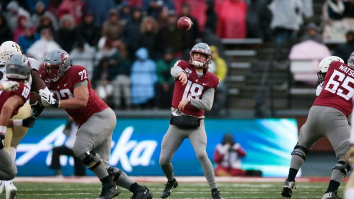 PULLMAN, WASHINGTON - OCTOBER 19: Quarterback Anthony Gordon #18 of the Washington State Cougars throws a pass against the Colorado Buffaloes in the first half at Martin Stadium on October 19, 2019 in Pullman, Washington. (Photo by William Mancebo/Getty Images)