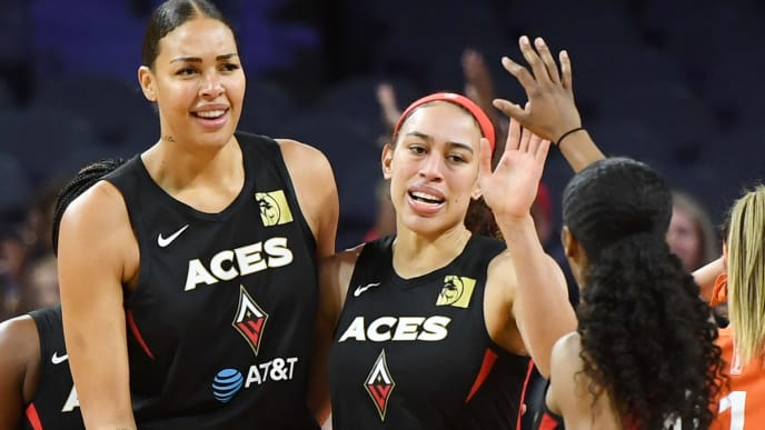 LAS VEGAS, NEVADA - JUNE 02:  (L-R) Liz Cambage #8, Dearica Hamby #5 and Sydney Colson #51 of the Las Vegas Aces celebrate on the court after Cambage scored and was fouled during a game against the Connecticut Sun at the Mandalay Bay Events Center on June 2, 2019 in Las Vegas, Nevada. The Sun defeated the Aces 80-74. NOTE TO USER: User expressly acknowledges and agrees that, by downloading and or using this photograph, User is consenting to the terms and conditions of the Getty Images License Agreement.  (Photo by Ethan Miller/Getty Images )
