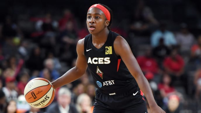 LAS VEGAS, NEVADA - AUGUST 11:  Jackie Young #0 of the Las Vegas Aces sets up a play against the Connecticut Sun during their game at the Mandalay Bay Events Center on August 11, 2019 in Las Vegas, Nevada. The Aces defeated the Sun 89-81. NOTE TO USER: User expressly acknowledges and agrees that, by downloading and or using this photograph, User is consenting to the terms and conditions of the Getty Images License Agreement.  (Photo by Ethan Miller/Getty Images )
