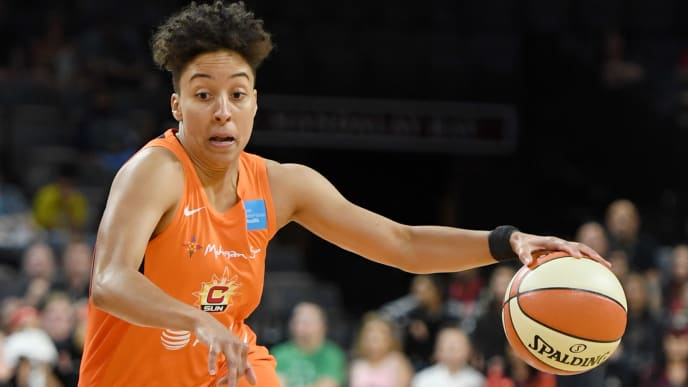 LAS VEGAS, NEVADA - JUNE 02:  Layshia Clarendon #23 of the Connecticut Sun drives against the Las Vegas Aces during their game at the Mandalay Bay Events Center on June 2, 2019 in Las Vegas, Nevada. The Sun defeated the Aces 80-74. NOTE TO USER: User expressly acknowledges and agrees that, by downloading and or using this photograph, User is consenting to the terms and conditions of the Getty Images License Agreement.  (Photo by Ethan Miller/Getty Images )
