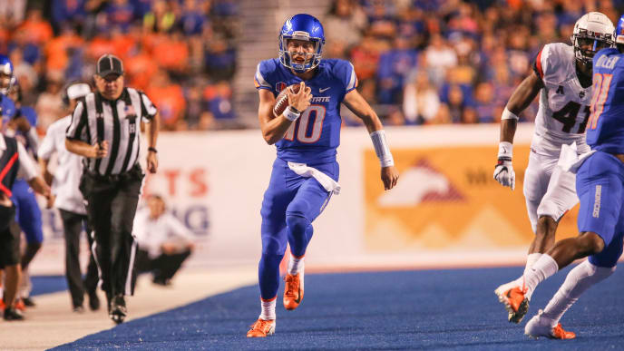 BOISE, ID - SEPTEMBER 8: Quarterback Chase Cord #10 of the Boise State Broncos runs down the sidelines during second half action against the Connecticut Huskies on September 8, 2018 at Albertsons Stadium in Boise, Idaho. Boise State won the game 62-7. (Photo by Loren Orr/Getty Images)