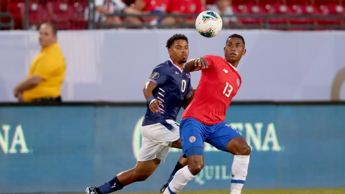 FRISCO, TEXAS - JUNE 20: Allan Cruz #13 of Costa Rica controls the ball against Zeiko Lewis #10 of Bermuda during the first half of the Costa Rica v Bermuda: Group B - 2019 CONCACAF Gold Cup at Toyota Stadium on June 20, 2019 in Frisco, Texas. (Photo by Tom Pennington/Getty Images)