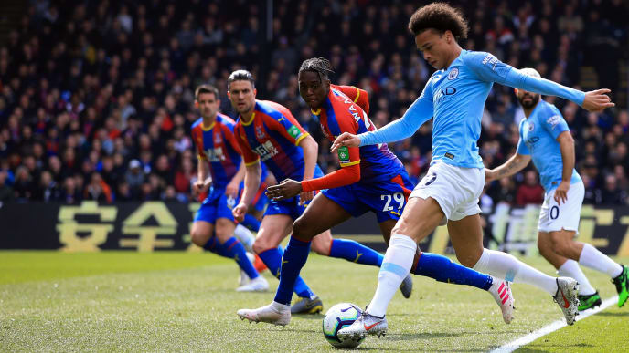 LONDON, ENGLAND - APRIL 14:  Leroy Sane of Manchester City takes on the Palace defenders during the Premier League match between Crystal Palace and Manchester City at Selhurst Park on April 14, 2019 in London, United Kingdom. (Photo by Marc Atkins/Getty Images)