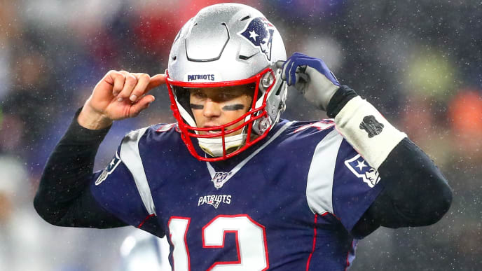 FOXBOROUGH, MA - NOVEMBER 24: Tom Brady #12 of the New England Patriots reacts during a game against the Dallas Cowboys at Gillette Stadium on November 24, 2019 in Foxborough, Massachusetts. (Photo by Adam Glanzman/Getty Images)